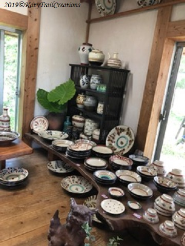 Personally, that slab table with all the pottery is something else!
