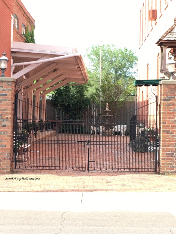 Courtyard with gate (door) between the buildings